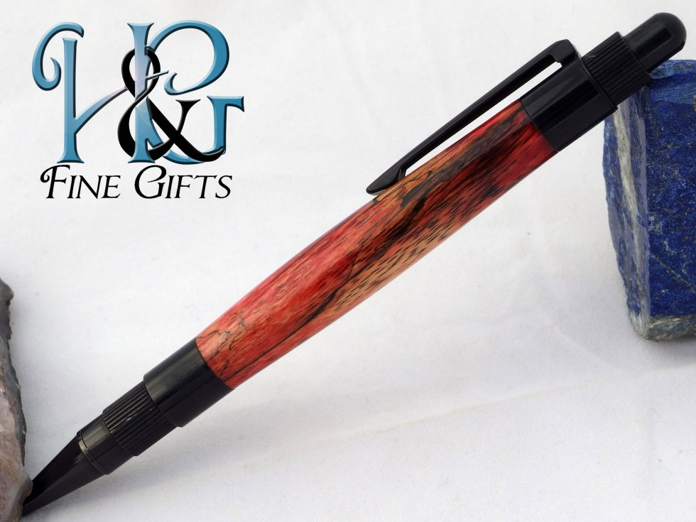 Red and black handcrafted pen in black setting