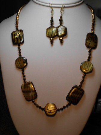 Decorated golden shell beads