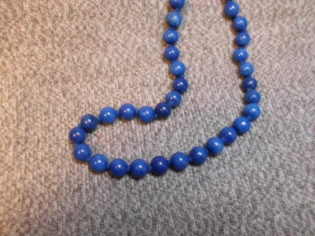 Knotted dyed blue beads
