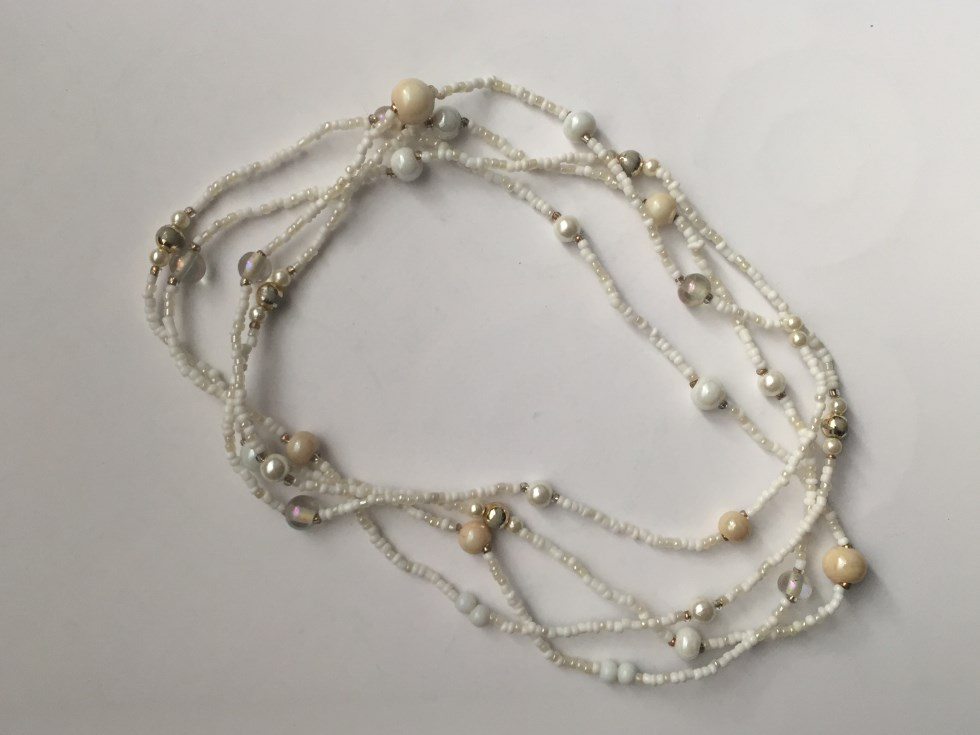 Single strand white beaded necklace
